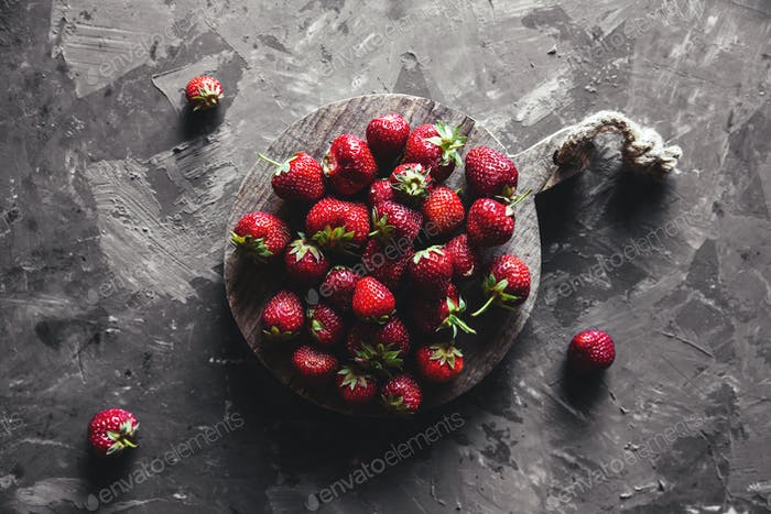 Strawberries on a gray background. Healthy and fresh food, fruit