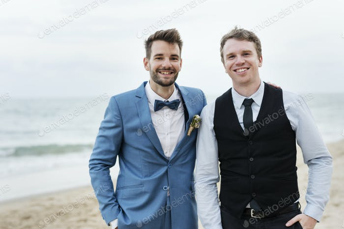 Groom and groomsman at the beach