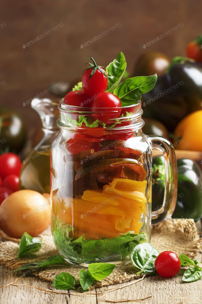 Vegan salad jar with yellow, black and red cherry tomatoes