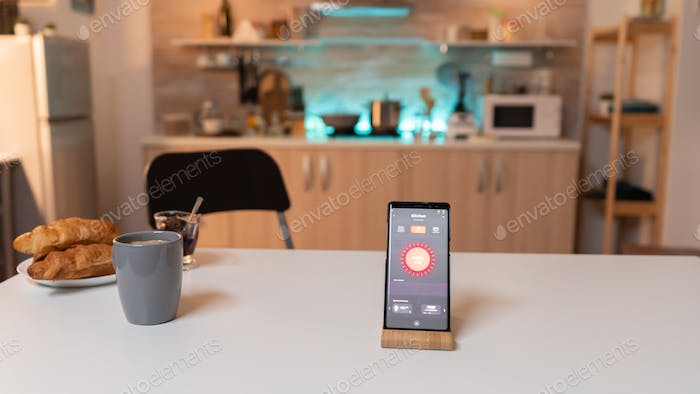 Smartphone with smart home application to turn on and off the lights
