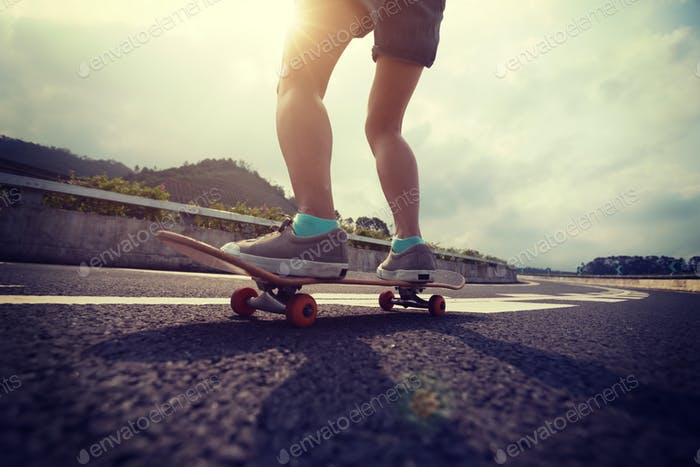 Riding skateboard on asphalt road