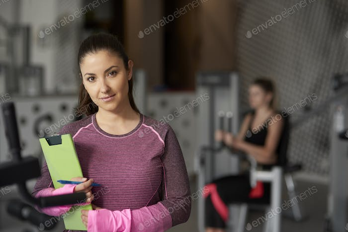 Portrait of personal trainer at the gym