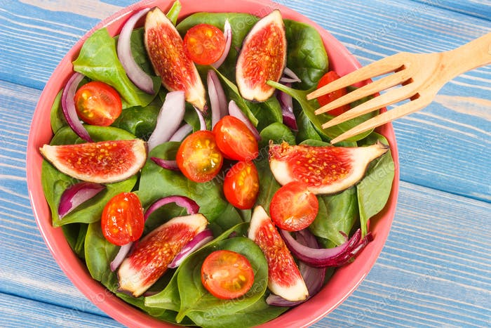 Fruit and vegetable salad with wooden fork, healthy lifestyle and nutrition concept