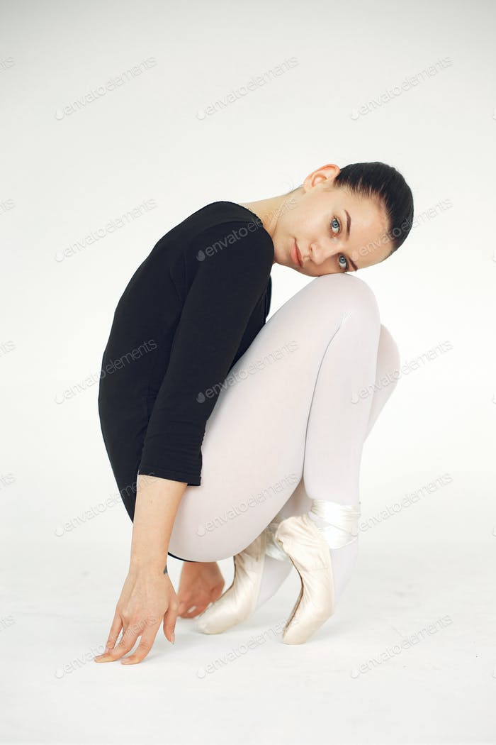 Ballerina posing in front of white background