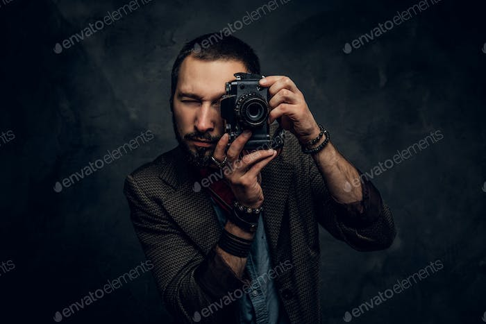 Reporter is taking a photo at photo studio