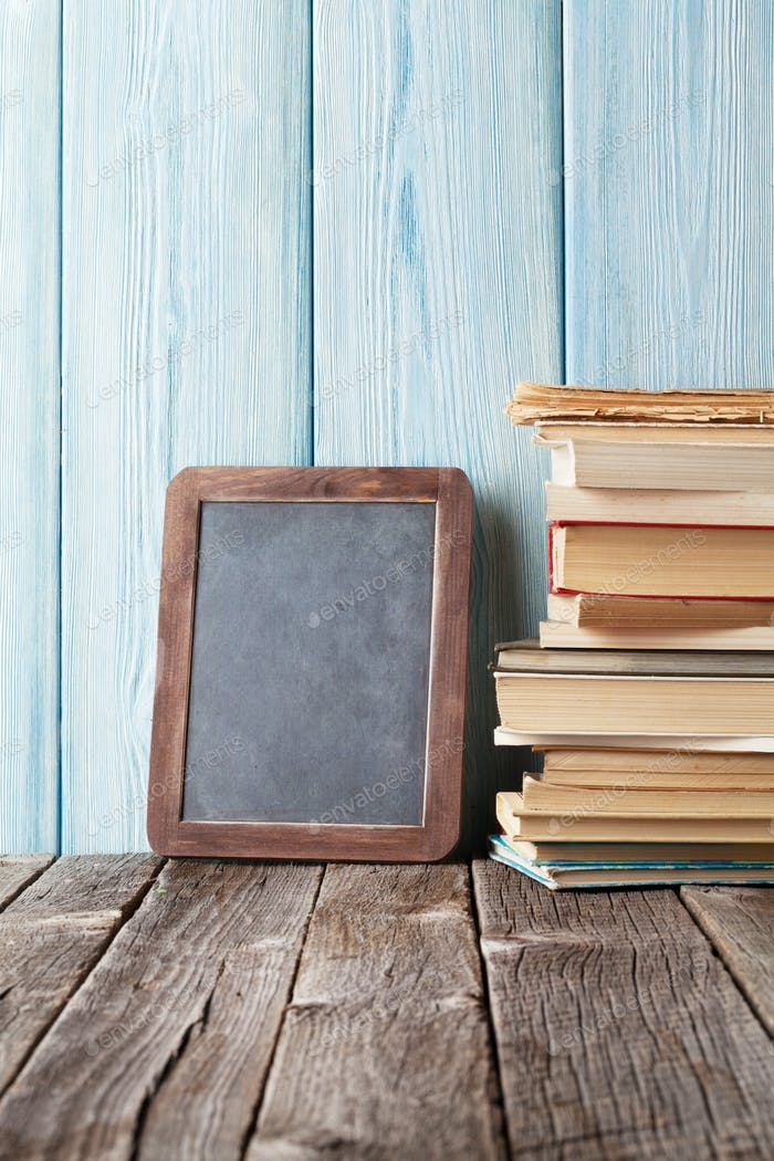 Books and chalk board for your text