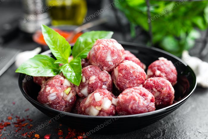 Beef meatballs. Cooking raw beef meatballs