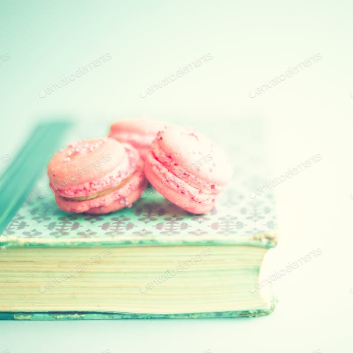 Pink macaroons in a book
