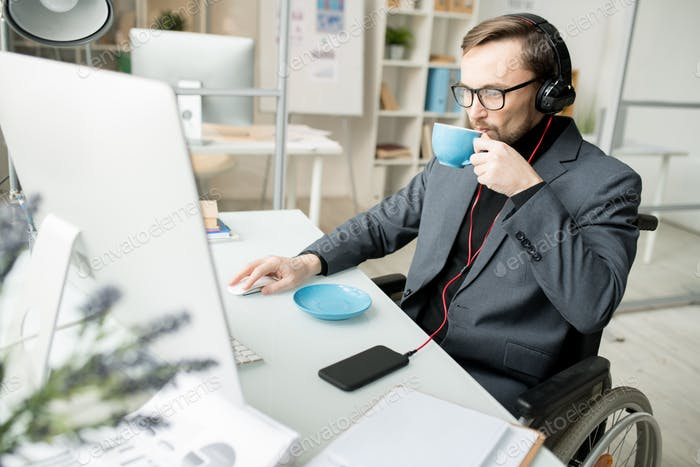 Disabled businessman working at office
