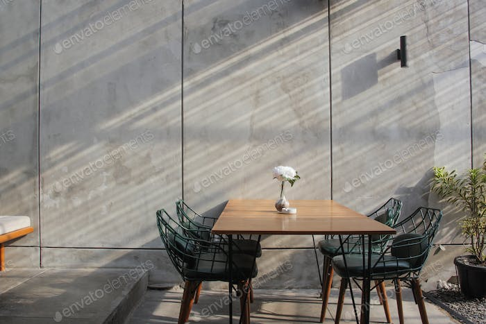 Dining room with industrial background concrete wall and pot plant