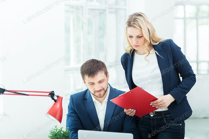 Male and female office workers.
