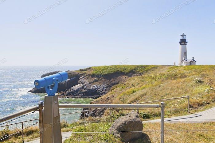 54380,Telescope overlooking lighthouse on cliff, Newport, Oregon, United States