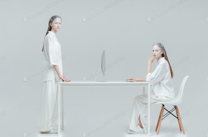 Two women using future technology