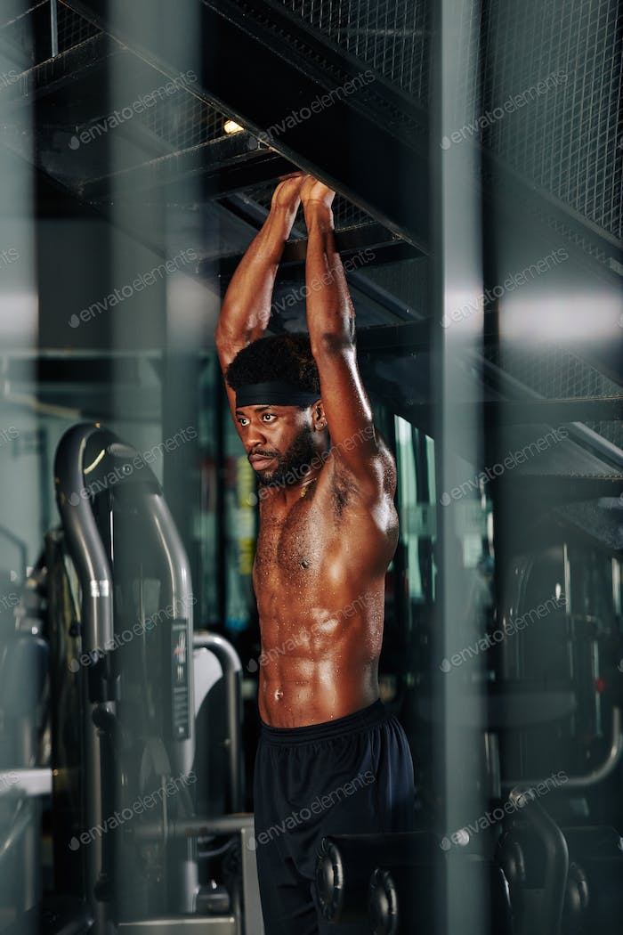 Sporty Black Guy Exercising