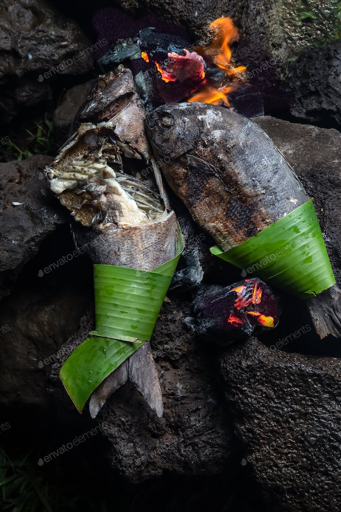 Easter Island food. Local fish prepared on hot stones. Top view.