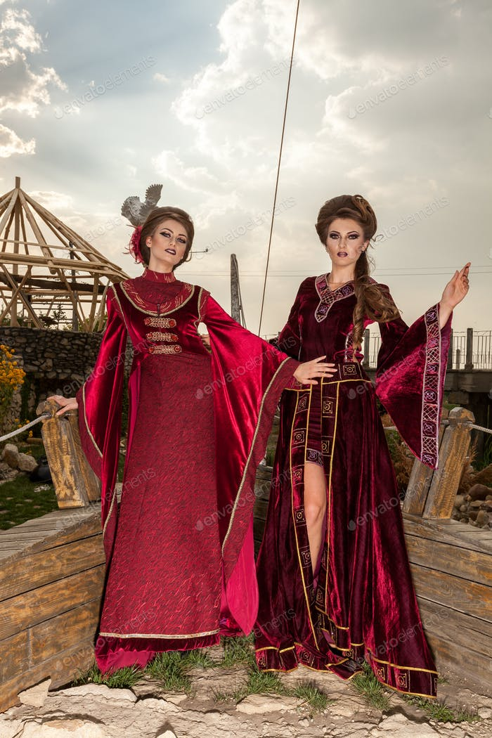 Two sensual ladies in vintage clothes on a boat