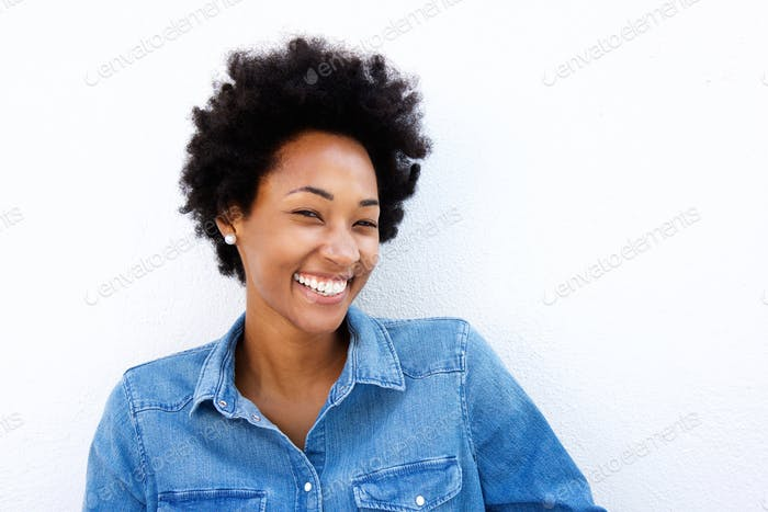 Cheerful woman smiling against white background