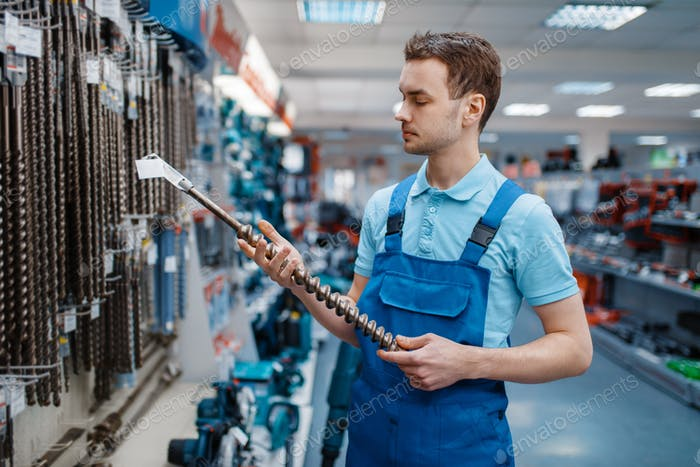 Employee choosing concrete drill in tool store