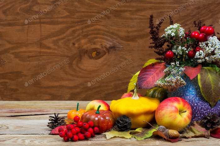 Fall arrangement with red berries, white flowers in purple vase