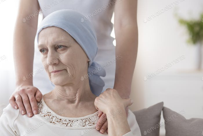 Crying elderly woman with cancer