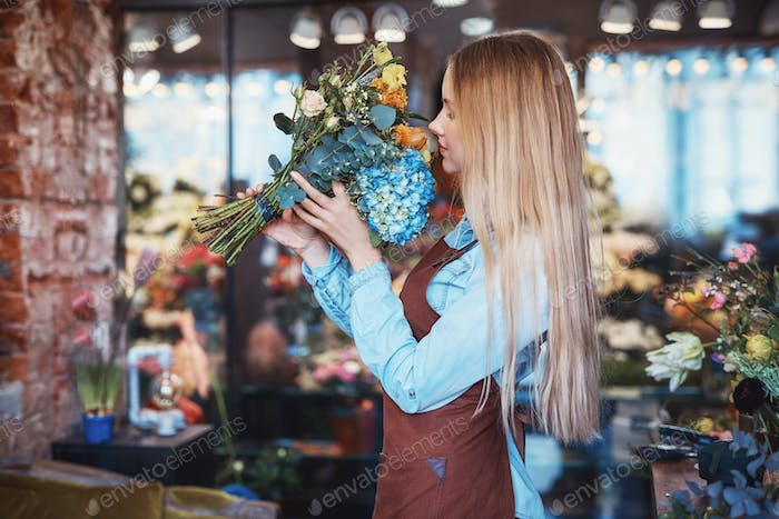 Working girl in uniform with flowers