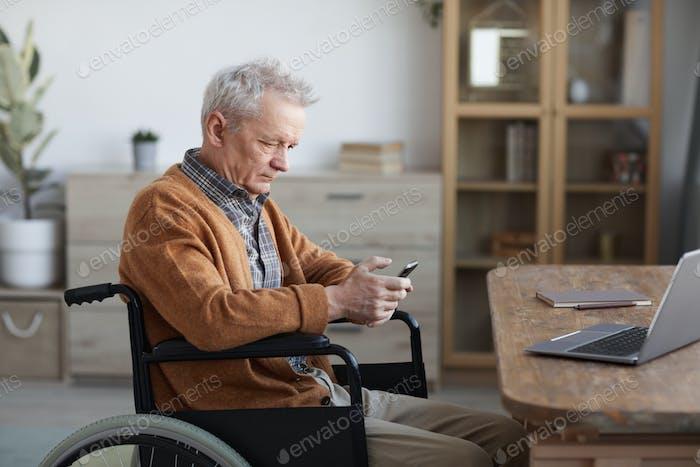 Senior Wheelchair User at Home