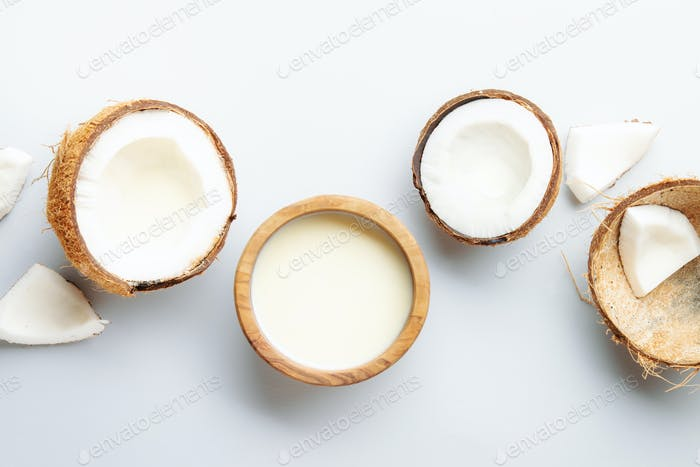 Coconut and bowl of coconut milk
