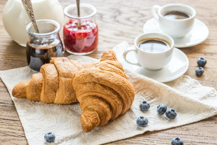 Croissants with  cups of coffee and milk