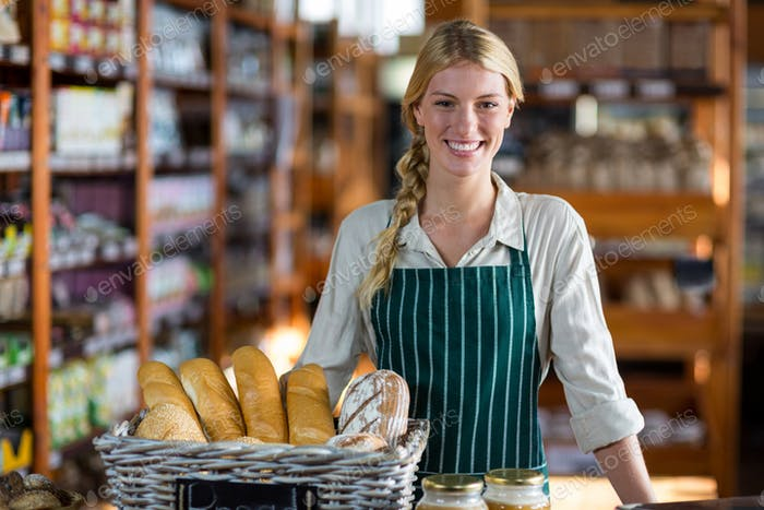 Female staff standing at bread counter
