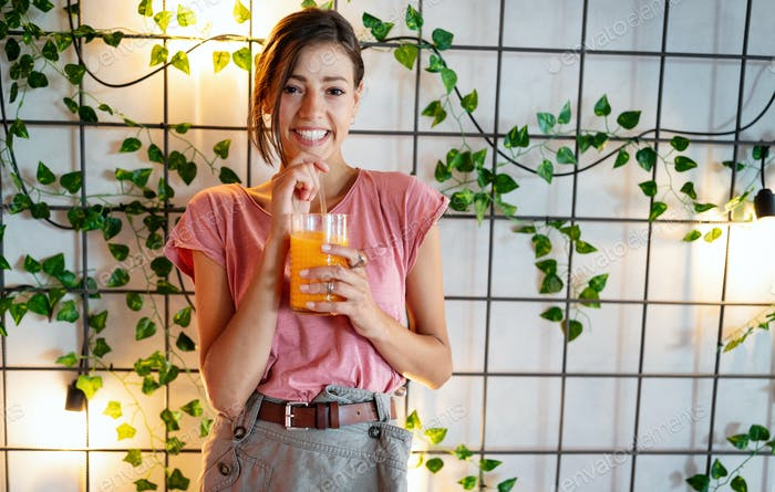 Woman drinking fresh raw juice. Healthy Lifestyle