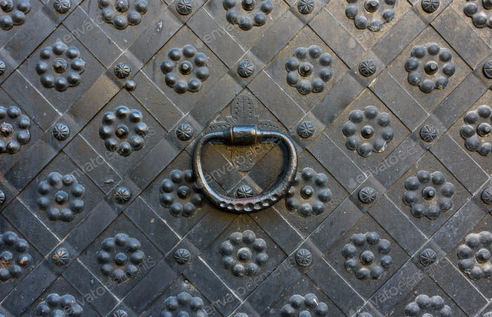 Elements of architectural decoration of ancient buildings, an old metal forged door.