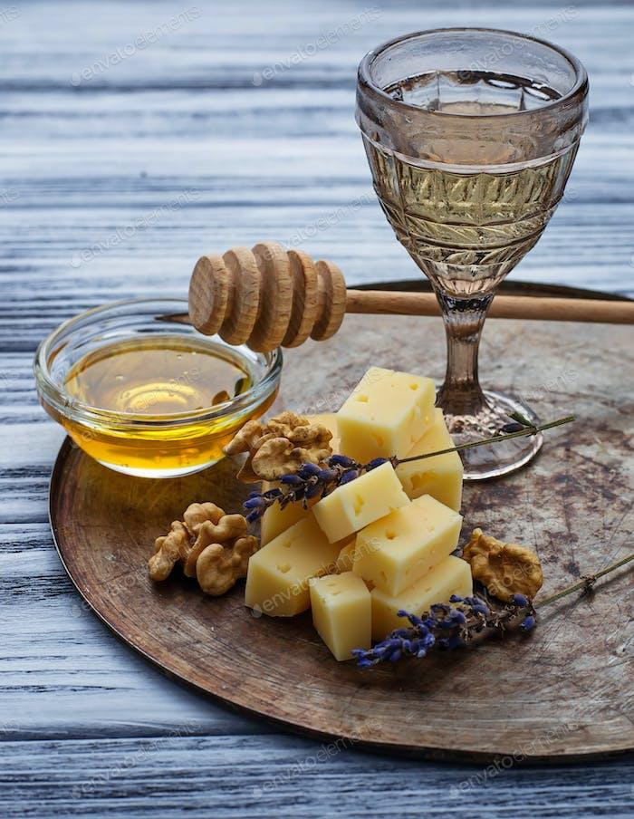 Cheese, nuts, honey and white wine