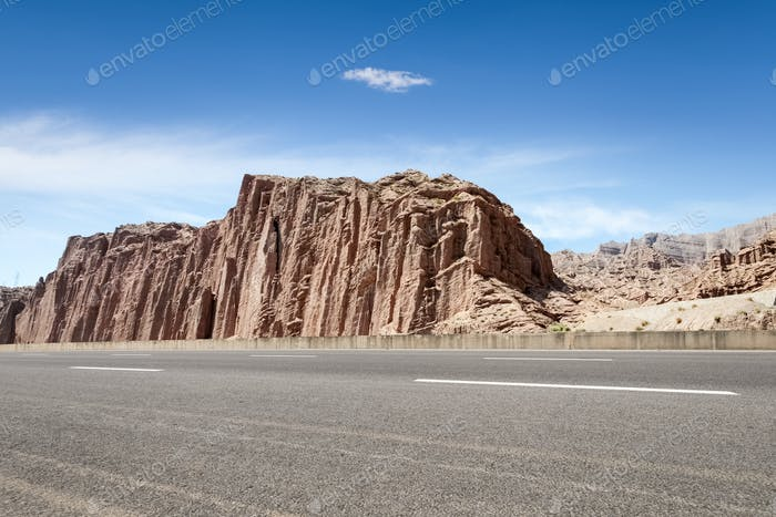 empty asphalt road with xinjiang geological landscape