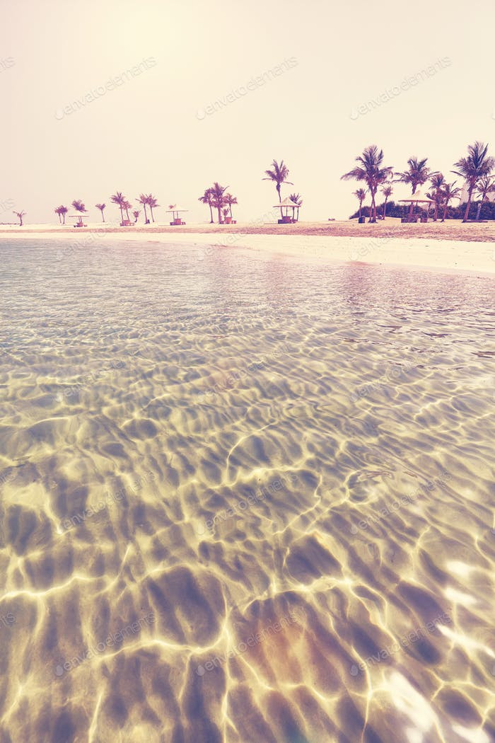 Retro stylized photo of a beautiful beach.