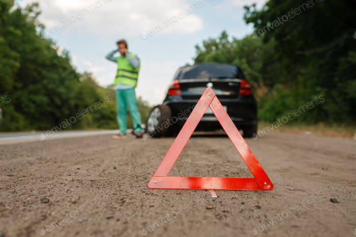 Emergency stop sign, car breakdown, flat tyre