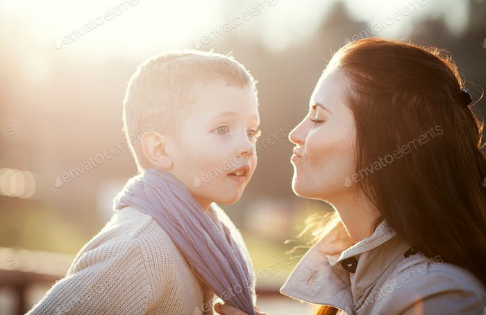 Mother and her child enjoy walk in park