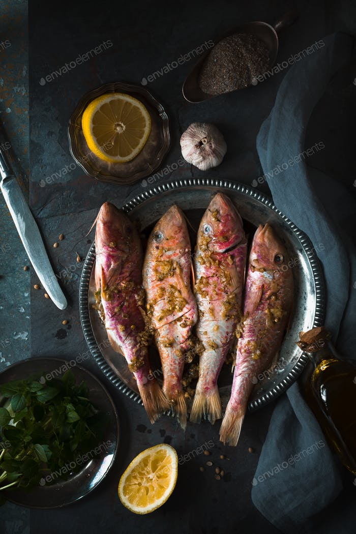 Plate of fried small fish red mullet and lemon