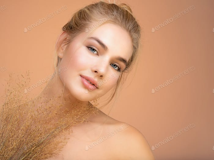 Closeup portrait of young beautiful woman with a healthy  skin of the face.