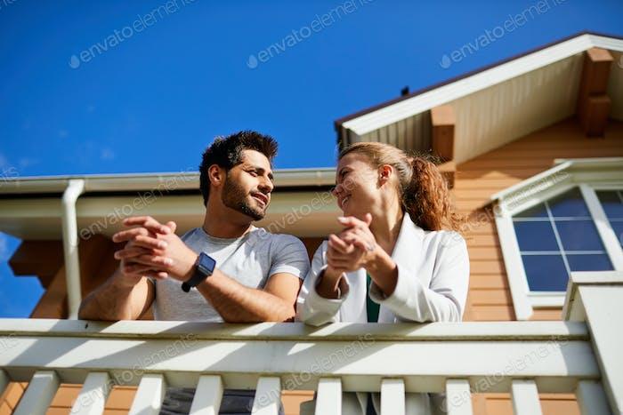 Talking on balcony