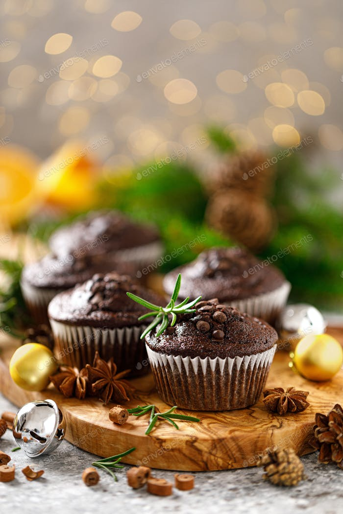 Christmas muffins. Chocolate Xmas or Noel festive bake with decorations and fir tree