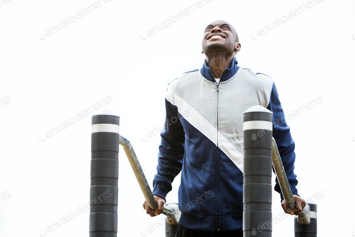 young man working out at outdoor gym