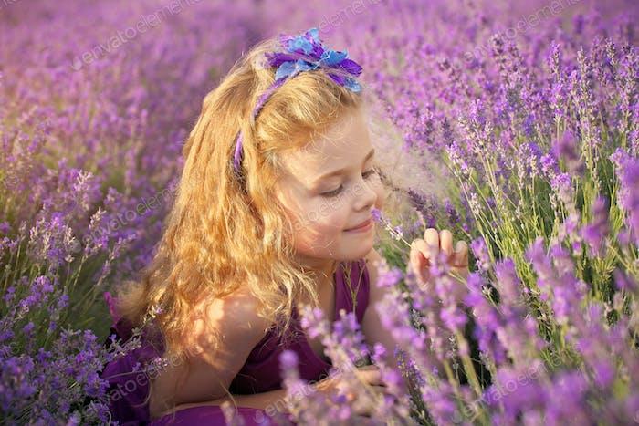 Little girl on lavender meadow.