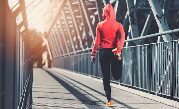 City workout. Beautiful woman training in an urban setting