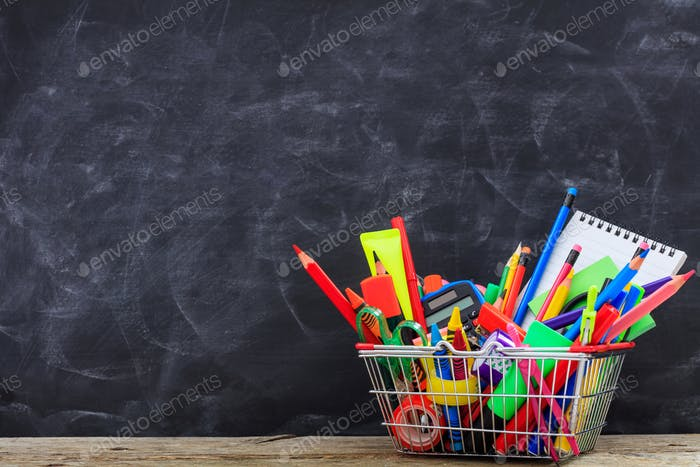 School shopping basket on blackboard background