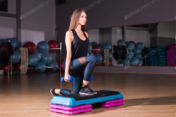 fitness, sport, training and lifestyle concept - woman with dumbbells in gym