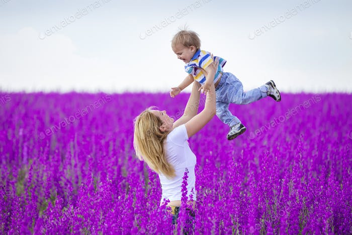 Young woman and her son having fun outdoors
