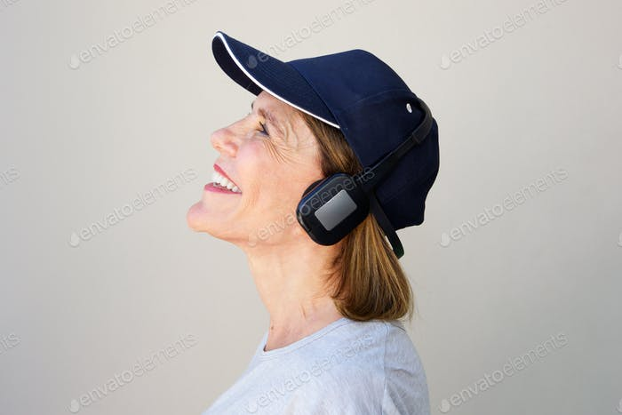 happy older woman enjoying music with headphones