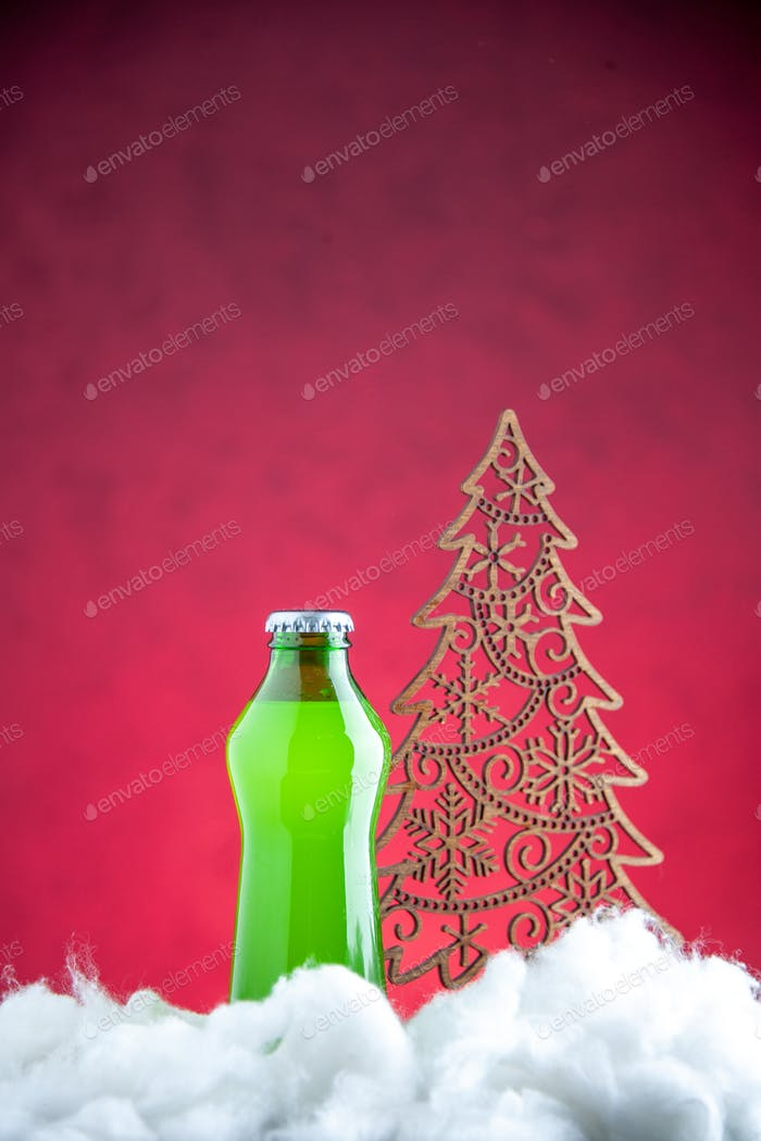 front view bottle of drink on pink background photo alcohol color drink xmas coke xmas