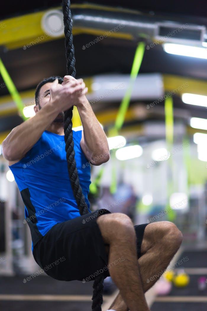 man doing rope climbing