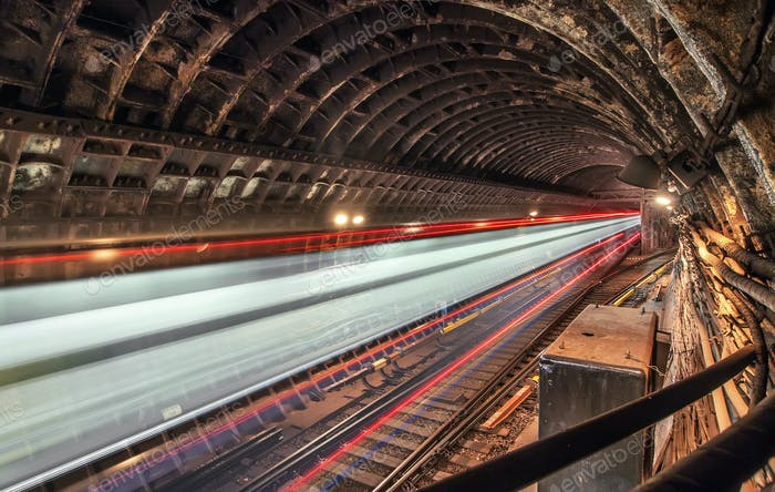 Subway tunnel with blurred light train